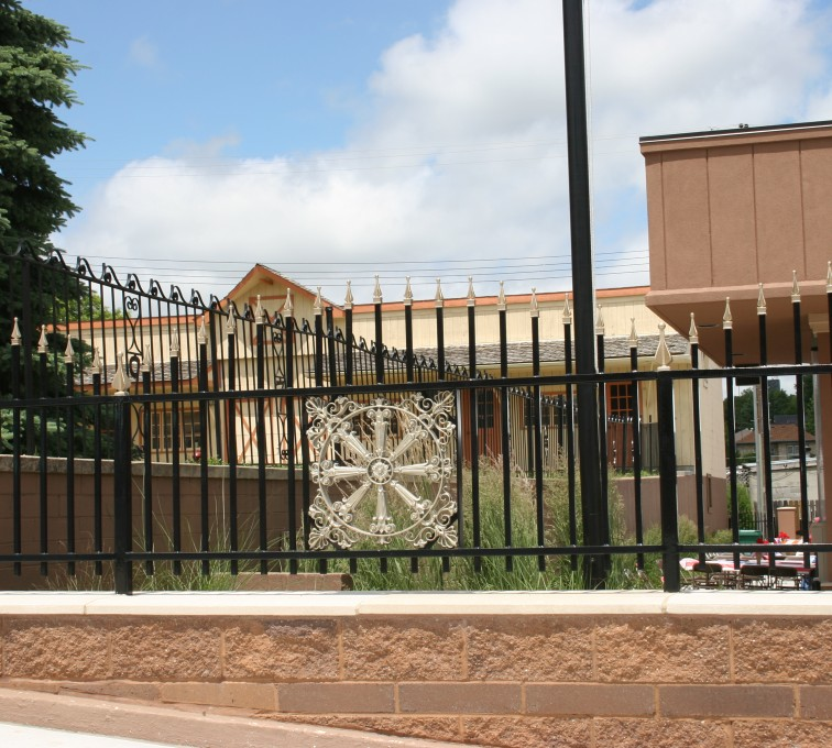 AFC Rochester - Custom Iron Gate Fencing, 1229 Overscallop with quad flare & emblem
