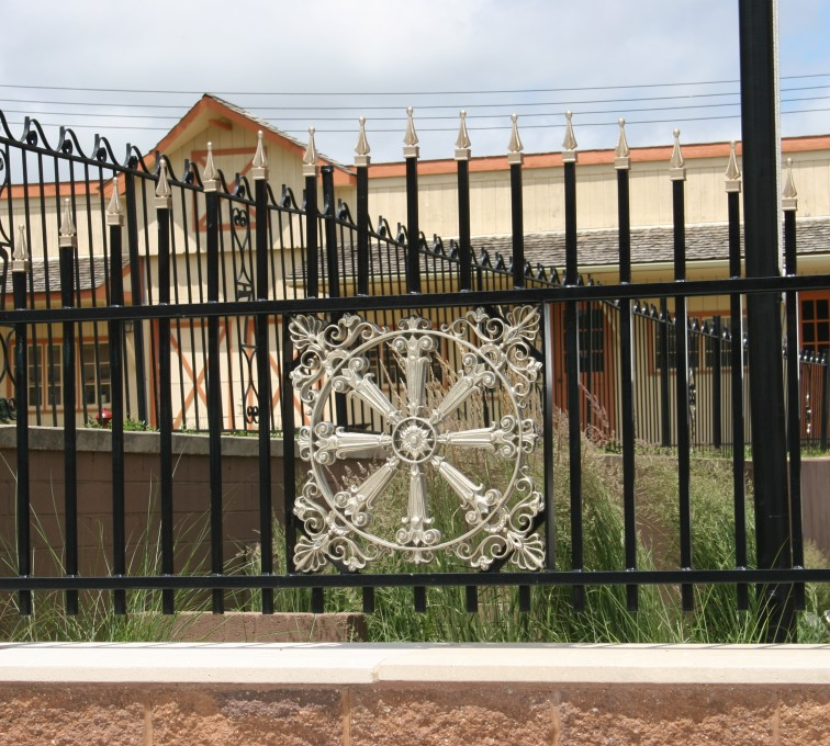 AFC Rochester - Custom Iron Gate Fencing, 1230 Overscallop with quad flare & emblem