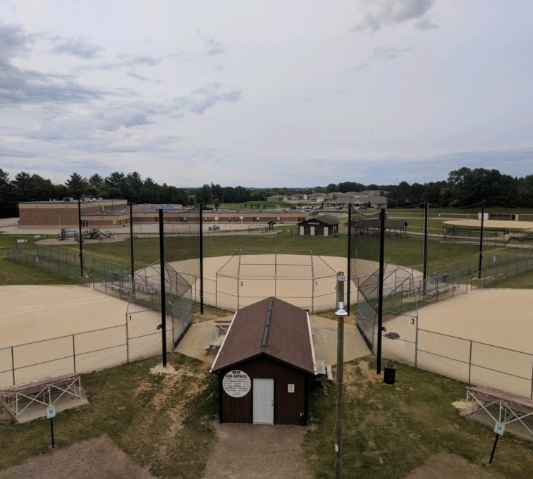 Black netting installed for a baseball field backstop