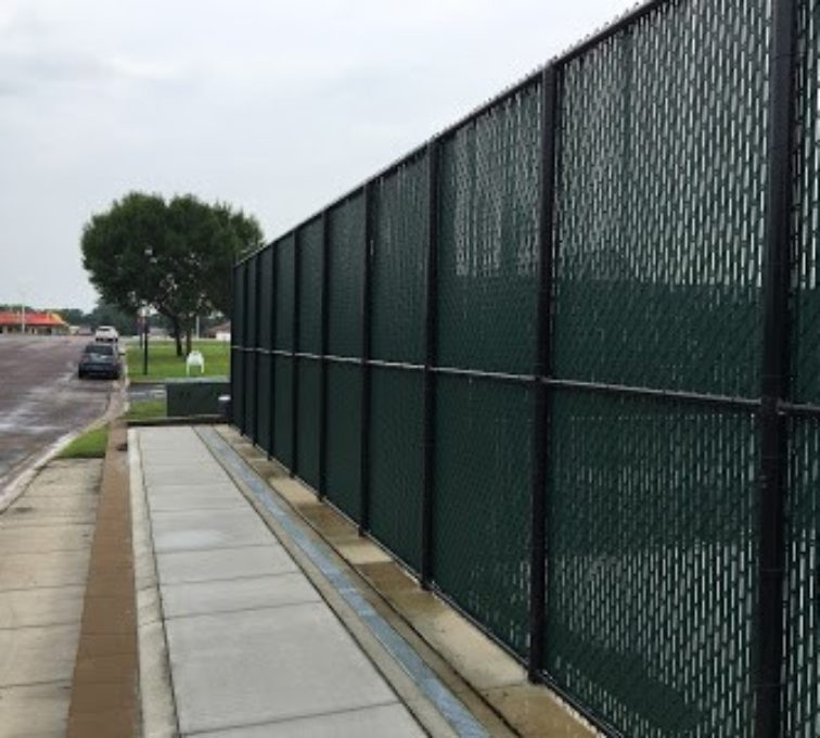 Privacy slats installed in a chain link fence for a tennis court