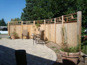 A curved custom wood privacy fence