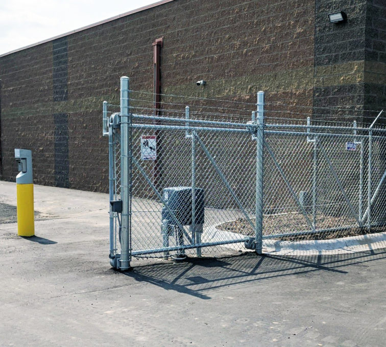 Steel slide gate with barb wire and gate opener and automated gate controls
