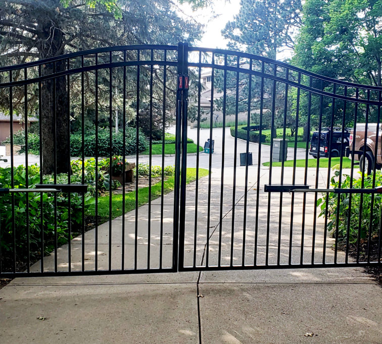 Arched residential swing gate with swing gate operators